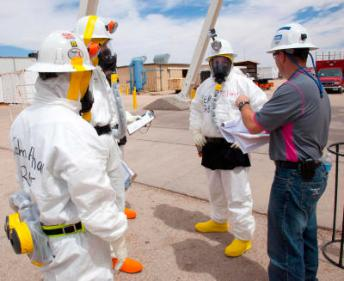 On April 2, 2014 workers wear protective clothing and positive air respirators while preparing to re-enter the WIPP underground facility for the first time since the February 14 radiological release. (Courtesy Department of Energy)